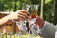 Glaswein eine Hand Stockfotografie