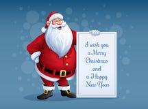 Glat Santa Claus anseende med julhälsningsbanret i arm Royaltyfri Fotografi
