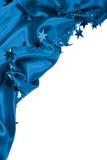 Glatte blaue Seide oder Satin mit Sternen als guten Rutsch ins Neue Jahr-Feiertag b Lizenzfreie Stockfotos