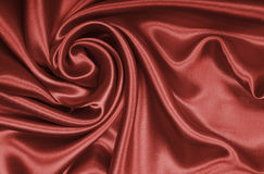 Glatte elegante braune Schokoladenseide als Hintergrund Lizenzfreie Stockfotos