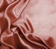 Glatte elegante braune Schokoladenseide als Hintergrund Lizenzfreie Stockfotografie