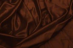 Glatte elegante braune Seiden- oder Satinbeschaffenheit kann als abstrakter Hintergrund verwenden Luxuriöse Hintergrunddesigntape Stockbild