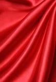 Glatte rote Seide als Hintergrund Lizenzfreies Stockfoto