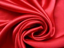 Glatte rote Seide als Hintergrund Stockfotos