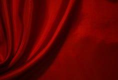Glatte rote Seide als Hintergrund Lizenzfreie Stockbilder