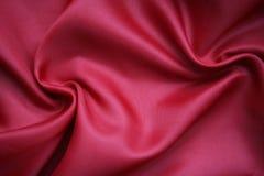 Glatte rote Seide als Hintergrund Stockbilder