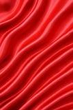 Glatte rote Seide als Hintergrund Stockfotografie
