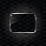 Glatte schwarze Platte auf einem metallischen Hintergrund. Stockbild