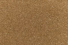 Glatte sogar Beschaffenheit oder Hintergrund Brown-Sandes lizenzfreie stockbilder