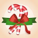 Glatte Zuckerstangen mit Band für Weihnachten vektor abbildung