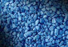 Glatter blauer Hintergrund des dekorativen Steins. Lizenzfreie Stockbilder