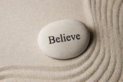 Glauben Sie Stein Stockbild