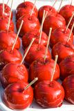 Glazed apples. Delicious glazed apples on sticks Royalty Free Stock Photography