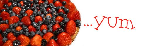 Glazed berries on a fruit tart royalty free stock photography