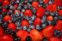 Glazed berries on a fruit tart royalty free stock photo