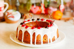Glazed bundt cake with white glaze on Christmas background Royalty Free Stock Images