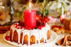 Glazed bundt cake with white glaze on Christmas background Royalty Free Stock Photo