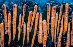 Glazed carrots on the baking tray Stock Photo