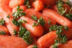 Glazed carrots with parsley macro. background, horizontal Royalty Free Stock Images