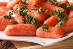 Glazed carrots with parsley on a plate macro. horizontal Stock Photography