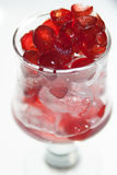 Glazed cherries with white back ground. Glazed cherries in a glass with some ice stock photos