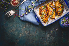 Glazed Chicken breast with Balsamic Vinaigrette and fresh flavoring on dark rustic background, top view. Border stock photo