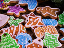 Glazed Christmas cookies on a wooden table. Stock Image