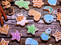 Glazed Christmas gingerbread on a wooden table. Royalty Free Stock Images