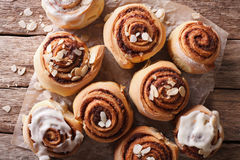 Glazed Cinnamon rolls with almond close up. horizontal top view Stock Photography