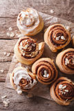 Glazed Cinnamon rolls with almond close up. vertical top view Stock Images