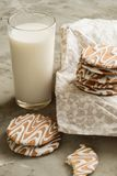 Glazed cookies and a glass of milk Stock Image