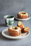 Glazed Cronut on a plate with a cup of coffee Stock Image