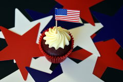 Glazed cupcakes or muffins decorated with american flag. Happy Independence Day, celebration, patriotism and holidays concept - close up of glazed cupcakes or Stock Photo