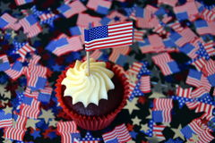 Glazed cupcakes or muffins decorated with american flag. Happy Independence Day, celebration, patriotism and holidays concept - close up of glazed cupcakes or Stock Images