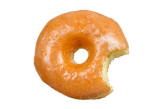 Glazed Donut with Bite Missing on White Background Stock Images