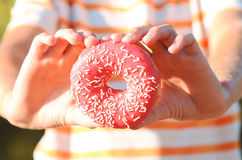 Glazed donut closeup Stock Photography