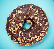 Glazed donut with colorful sprinkles on blue pastel background. Royalty Free Stock Photos