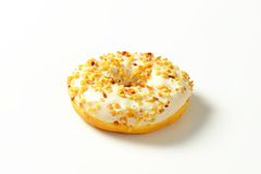 Glazed donut with nuts Royalty Free Stock Photo