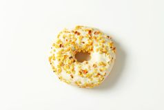 Glazed donut with nuts Royalty Free Stock Photography
