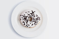 Glazed donut on the plate Stock Image