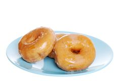 Glazed Donuts On Blue Plate Stock Image