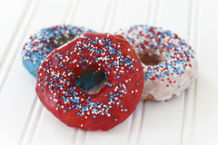 Glazed donuts in blue, red and white Stock Photo
