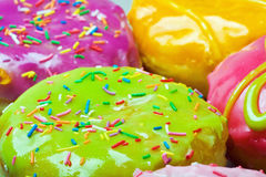 Glazed donuts with filling Royalty Free Stock Image
