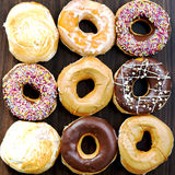 Glazed Doughnuts with colourful sprinkles, chocolate, icing Royalty Free Stock Images