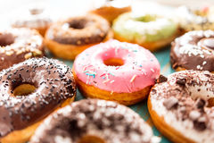 Glazed doughnuts with sprinkles Stock Images