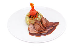 Glazed duck fillet with rice garnish Royalty Free Stock Photography