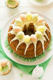 Glazed Easter cake decorated candy eggs Stock Photos