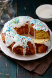Glazed Easter cake on wooden table Stock Photos