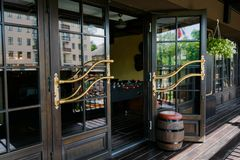 Glazed entrance to the luxurious restaurant stock images