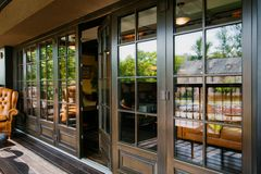 Glazed entrance to the luxurious restaurant Royalty Free Stock Image
